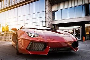 Red fast sports car in modern urban sett