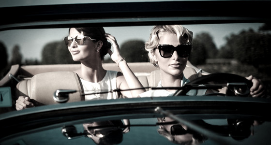 Two stylish women in a convertible