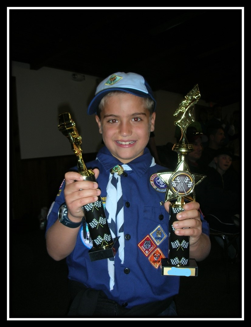 Kid with trophies