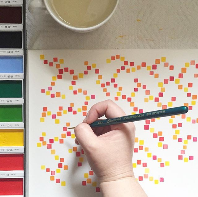 image: Kimberly painting a freehand watercolor pattern