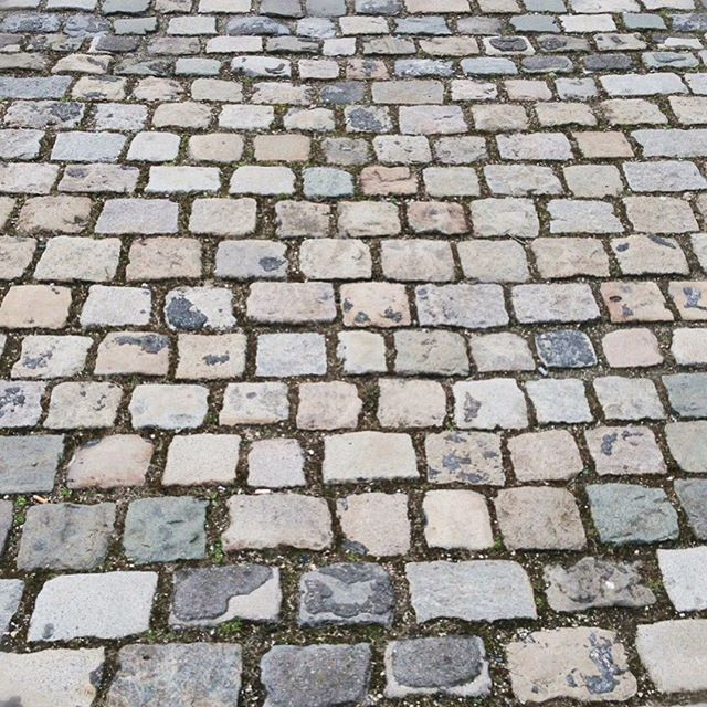 Photo of a cobblestoned street.