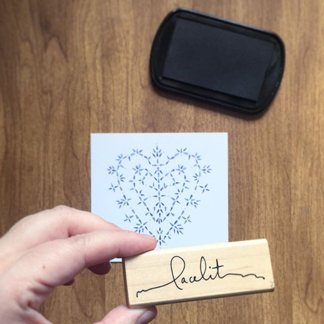 Photo of a Lacelit heart design, ink pad, and Kimberly holding a Lacelit rubber stamp.