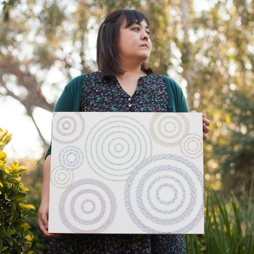 Kimberly holding original painting