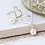 Thumbnail: Worn silver heart and ivory pearl drop earrings