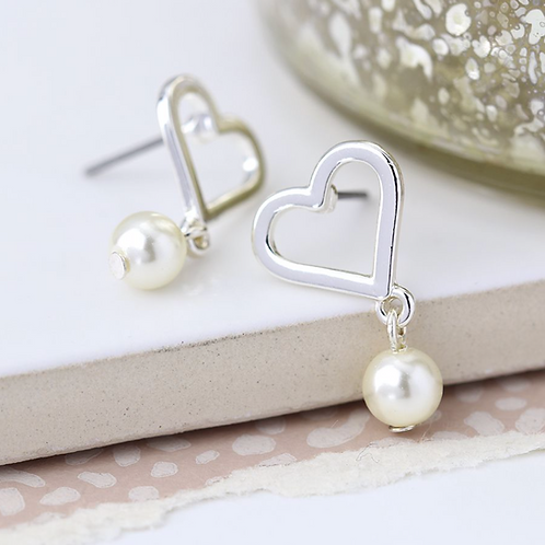 Worn silver heart and ivory pearl drop earrings