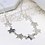 Thumbnail: Worn silver multi star necklace with crystals