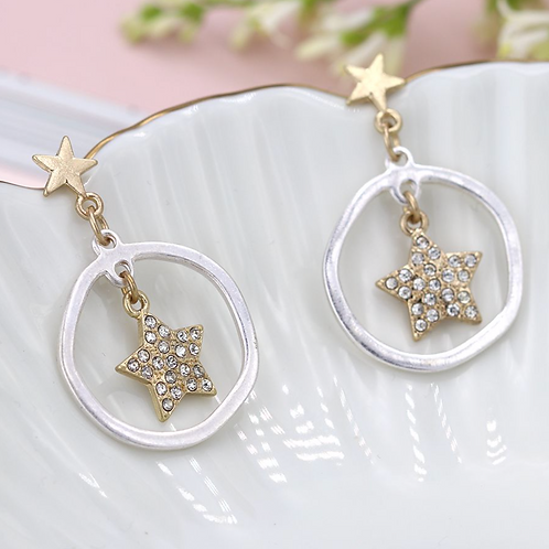 Worn gold crystal inset star in silver hoop earrings