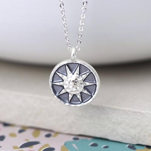 Grey enamel worn silver sun and crystal necklace