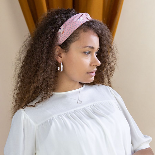 Pink fabric headband with grey dot print and white flowers