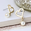 Thumbnail: Worn gold heart and ivory pearl drop earrings
