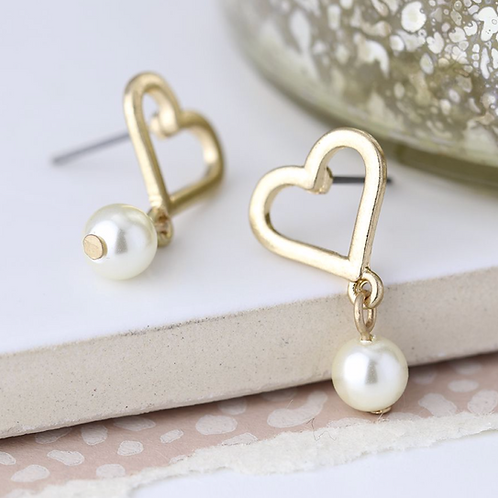 Worn gold heart and ivory pearl drop earrings