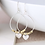 Thumbnail: Worn silver teardrop earrings with golden beads and heart