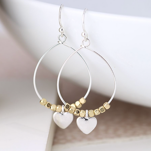 Worn silver teardrop earrings with golden beads and heart