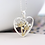 Thumbnail: Silver plated heart necklace with golden floral centre
