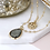 Thumbnail: Gold plated disc and smoky crystal layered necklace