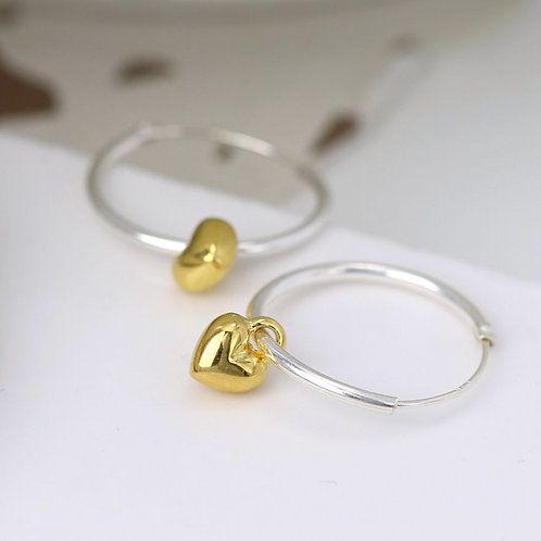 Sterling silver hoop earrings with gold hearts
