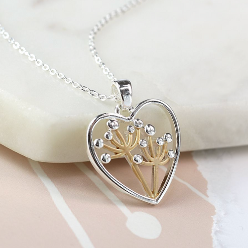 Silver plated heart necklace with golden floral centre