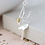 Thumbnail: Silver plated winged fairy necklace with golden hair
