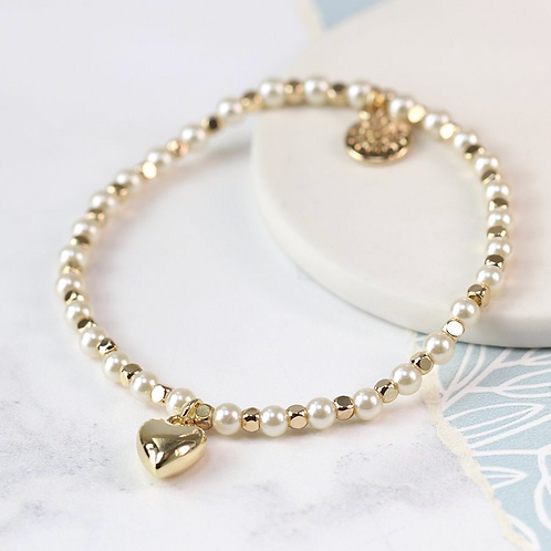 Gold bead and pearl bracelet with gold plated heart
