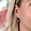 Thumbnail: Sterling silver hoop earrings with gold hearts