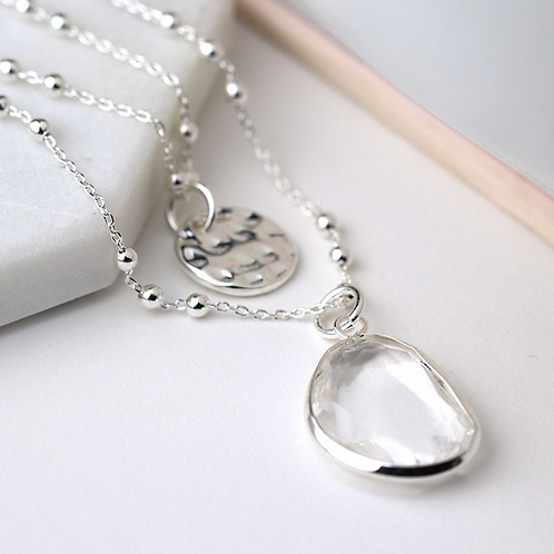 Silver plated disc and clear crystal layered necklace