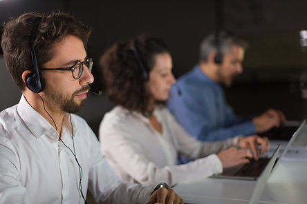 concentrated-bearded-call-center-operato