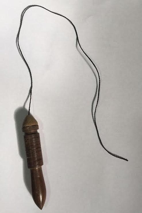Pêndulo de madeira