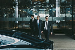 businessman-and-two-bodyguards-walking-t
