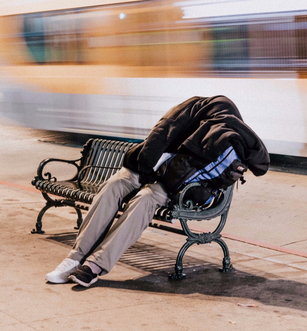 Homeless individual on bench | Connect To Care