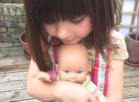 An adorable moment of a girl with her doll