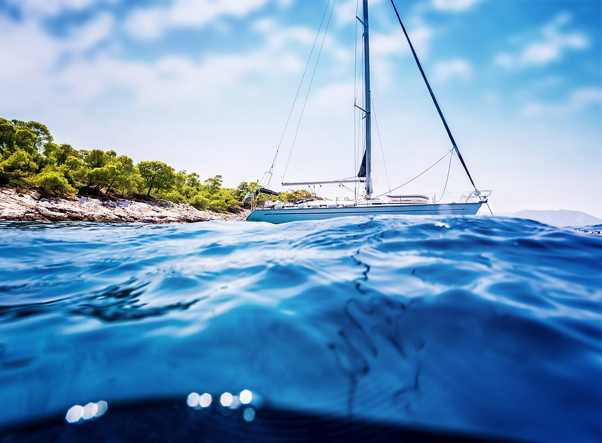 luxury-sailboat-near-tropical-island-PTN