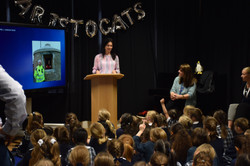 Dr Nicola Stacey speaks at a school assembly.