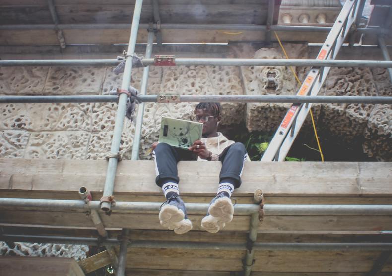 Arnaud climbs the scaffolding