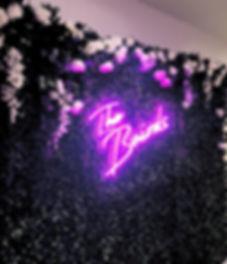 Wisteria Wonder at a wedding with neon light_edited.jpg