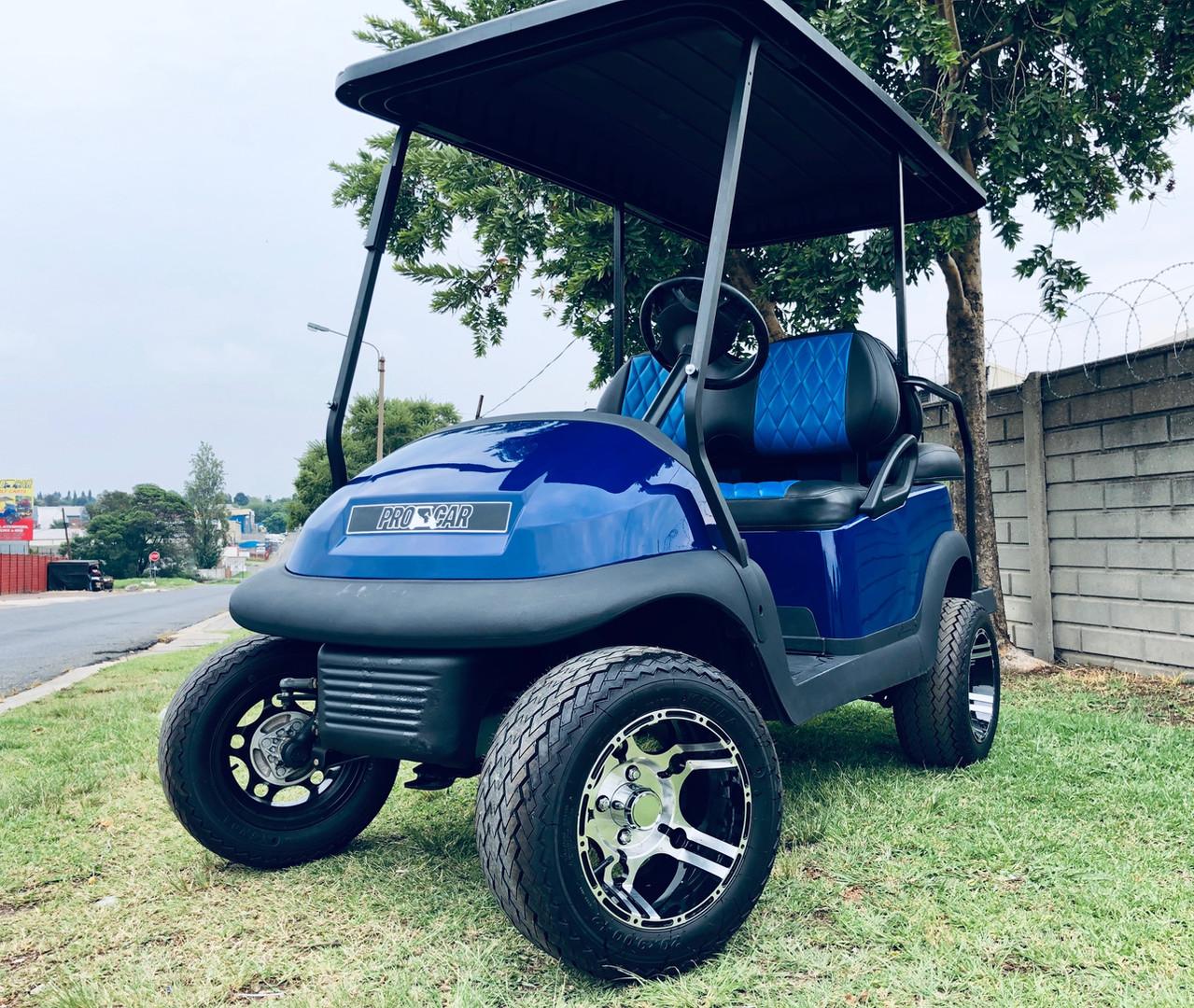 Blue and black golf cart