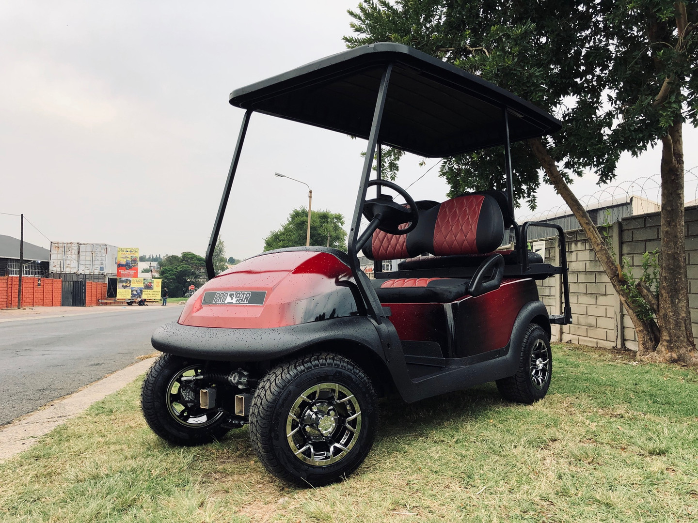 Red and black golf cart