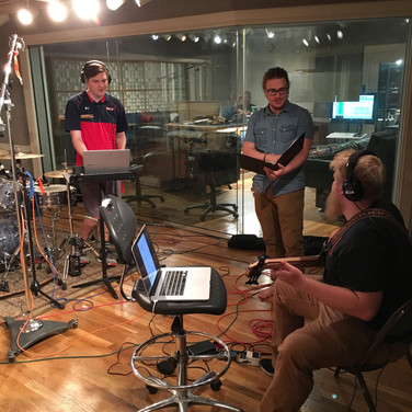 Producer Anthony, Drummer Zach, and Bassist Andy work out some things on a tracking session.