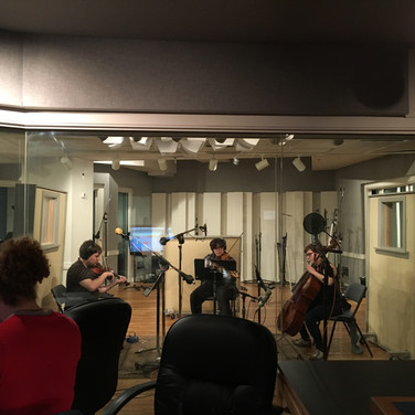 When you don't have a huge orchestral budget, you learn to improvise and record a string section with only a few players!
