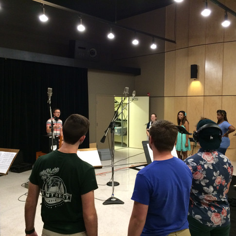 Here you can see Anthony conducting the choir for a project