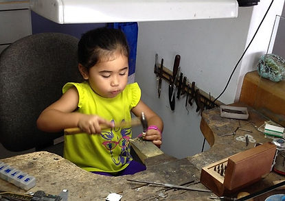 Jim's 3 year old granddaughter in action at the workbench. Adorable and Intense!