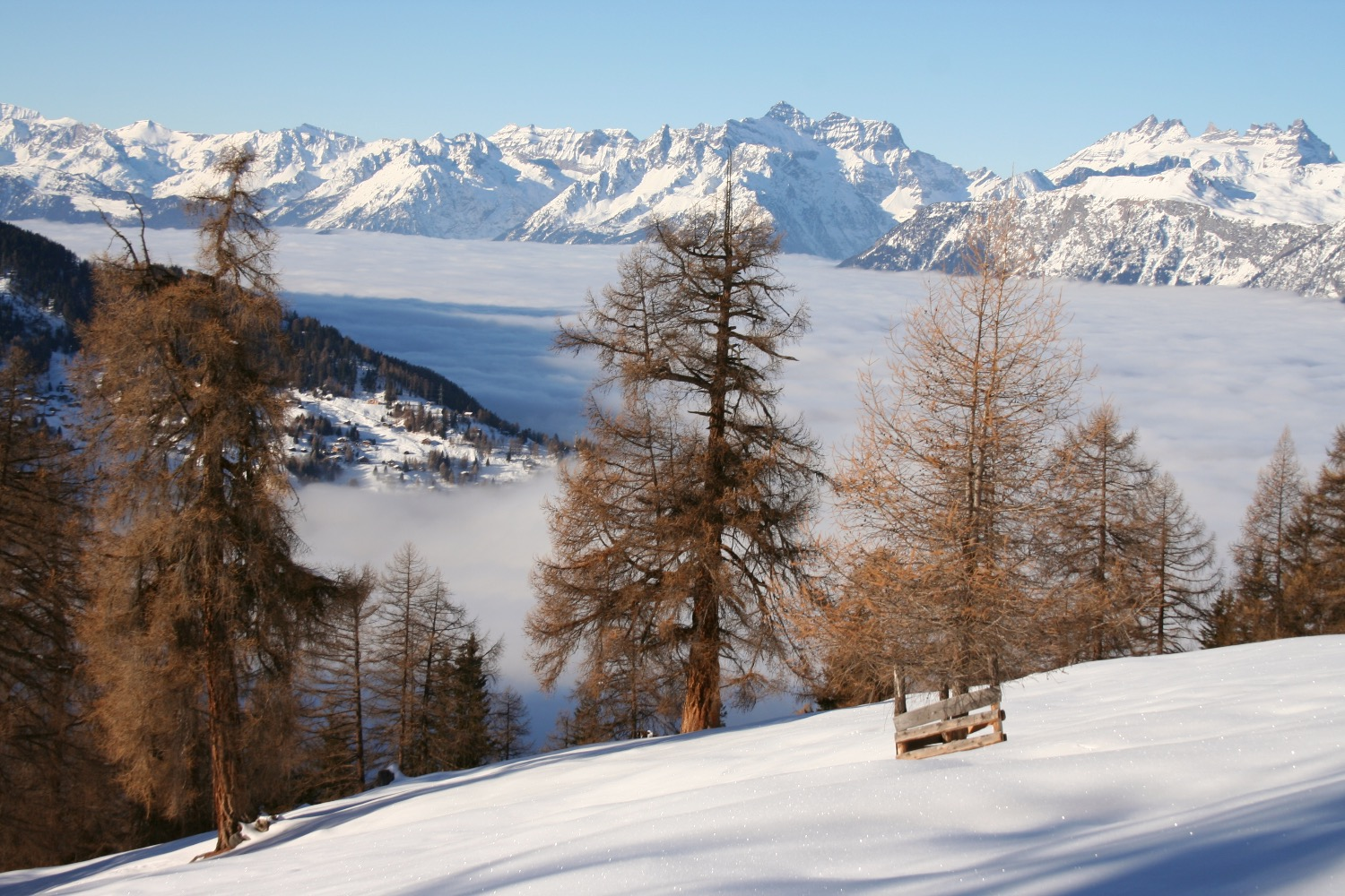 Prarion piste Nendaz above the clouds and the Rhone Valley