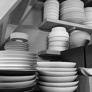 Rob Sollis stacks of tableware handthrow