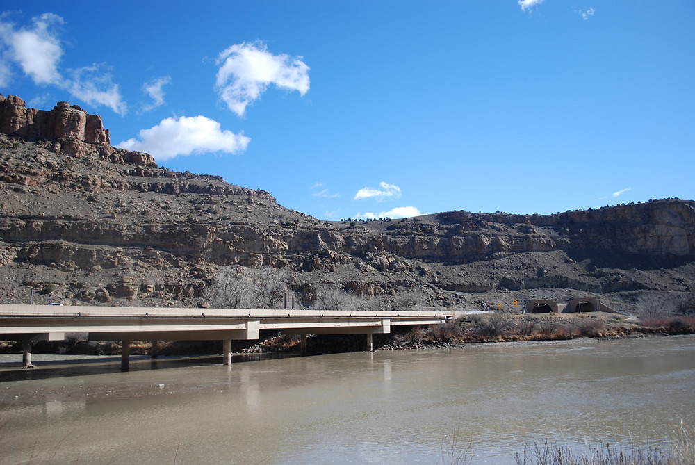 The Colorado River with Interstate highway 70 built along a mountain side.