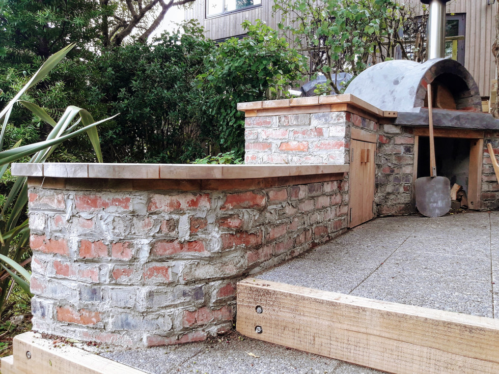 Outdoor pizza kitchen - crafted to reflect existing brickwork and surrounds