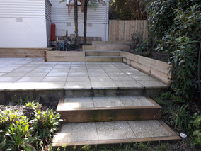 Paved patio with sleeper border retaining
