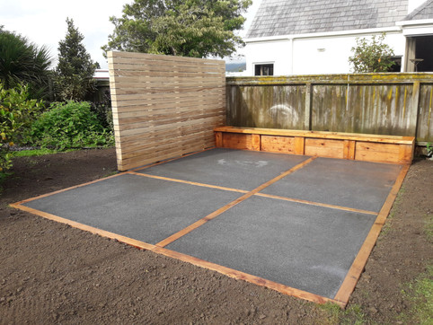 Pine screen, macrocarpa planter and and patio edging set in exposed aggregate paving