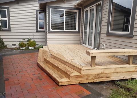Wideboard deck onto relaid brick paving