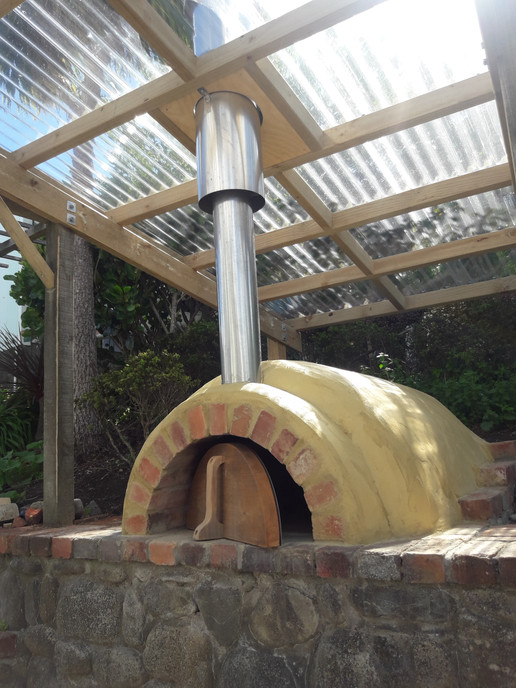 Pizza oven under cover