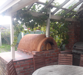 Covered outdoor pizza oven kitchen