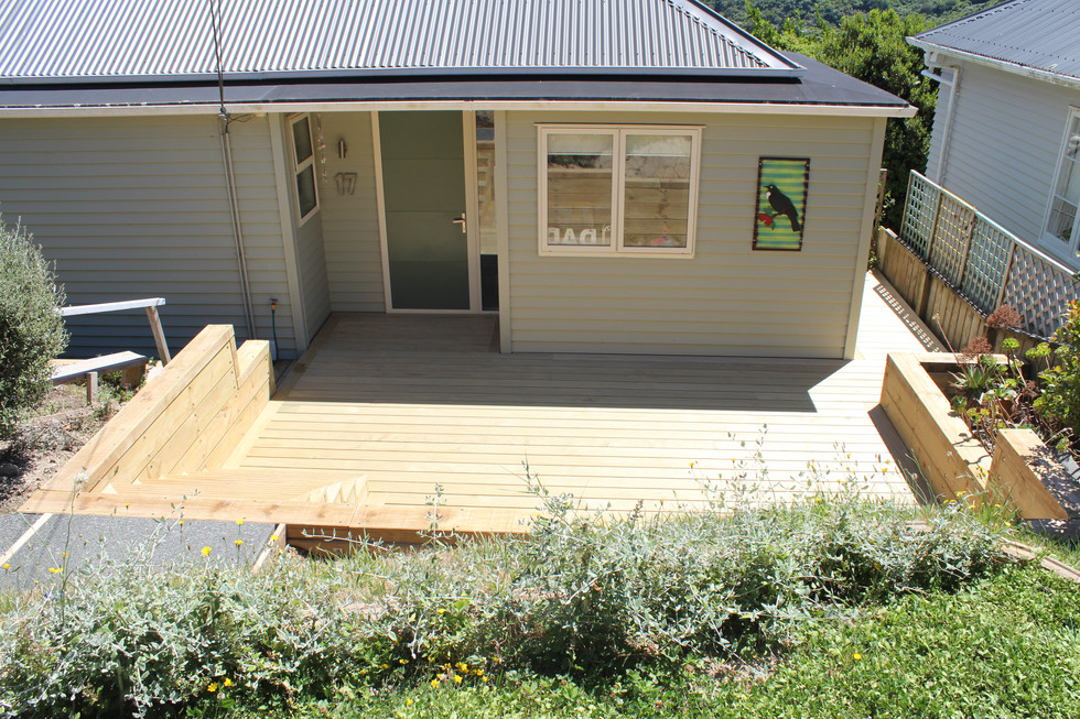 Front steps down to wideboard pine decking with pine sleeper borders
